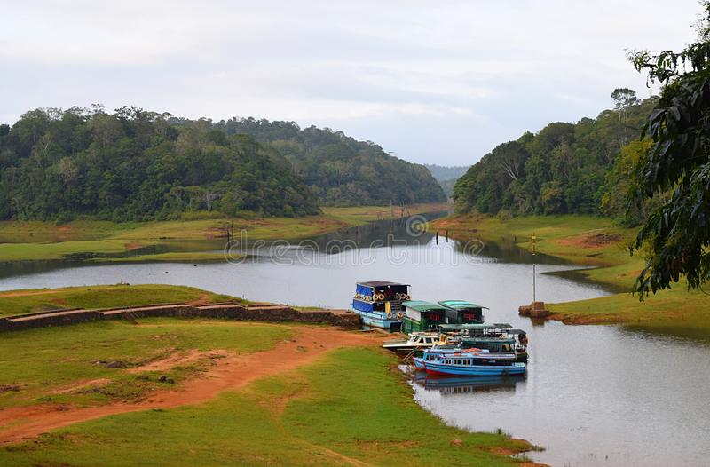 Boats in Periyar Lake and National Park, Thekkady, Kerala, India. This is a photograph of boats in Periyar Lake and Periyar National Park, located in Thekkady in stock photo