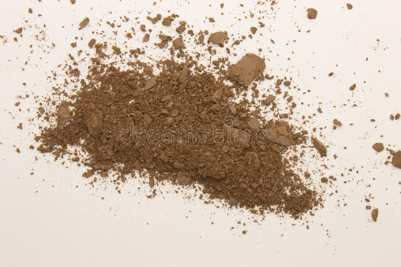 Bronzer powder. This is a photograph of a Bronzer powder makeup isolated on a White background royalty free stock photography