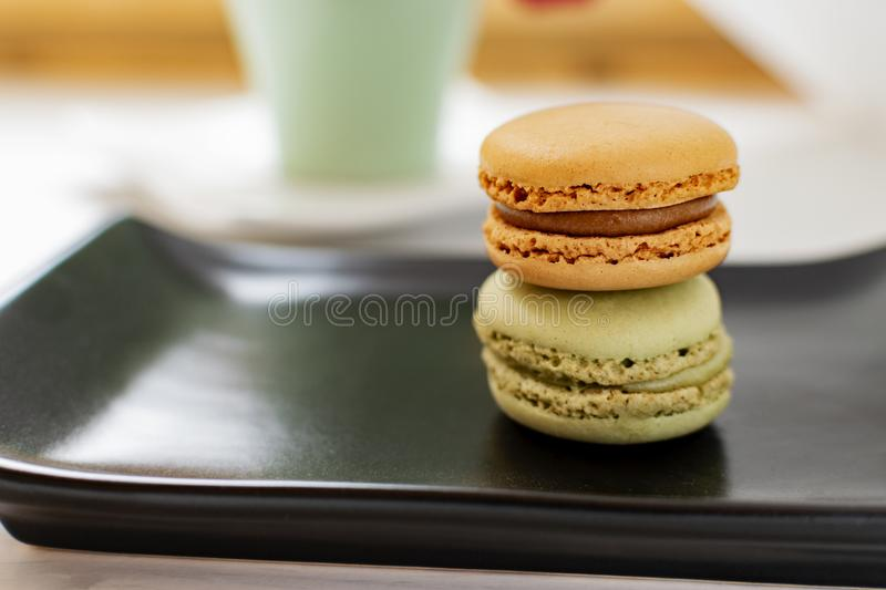 Macarons with tea. royalty free stock photos