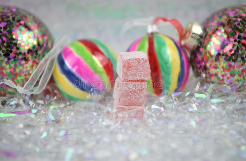 Christmas food photography picture with old fashioned turkish delight sweets and bauble tree decorations in the background. Photograph of Christmas food image royalty free stock images
