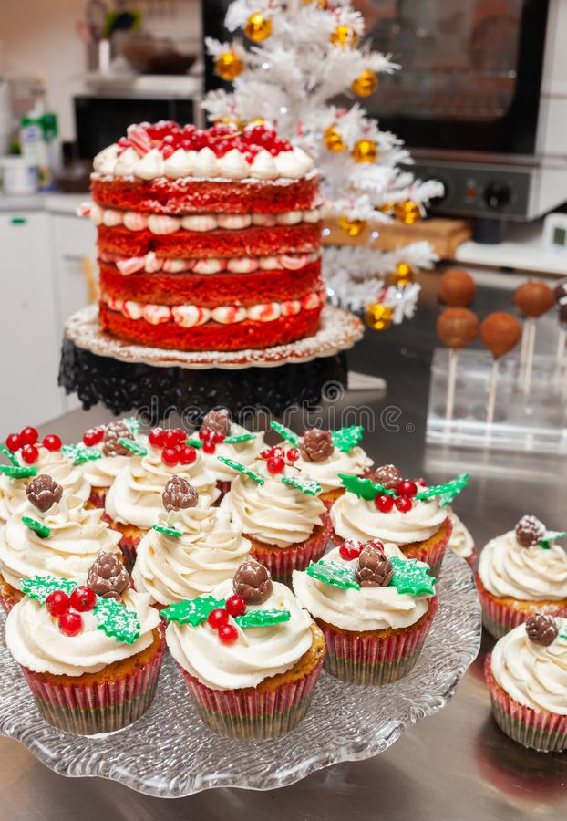 Red velvet cake and gingerbread cupcake. Photograph of christmas sweets, red velvet cake and gingerbread cupcake royalty free stock photos