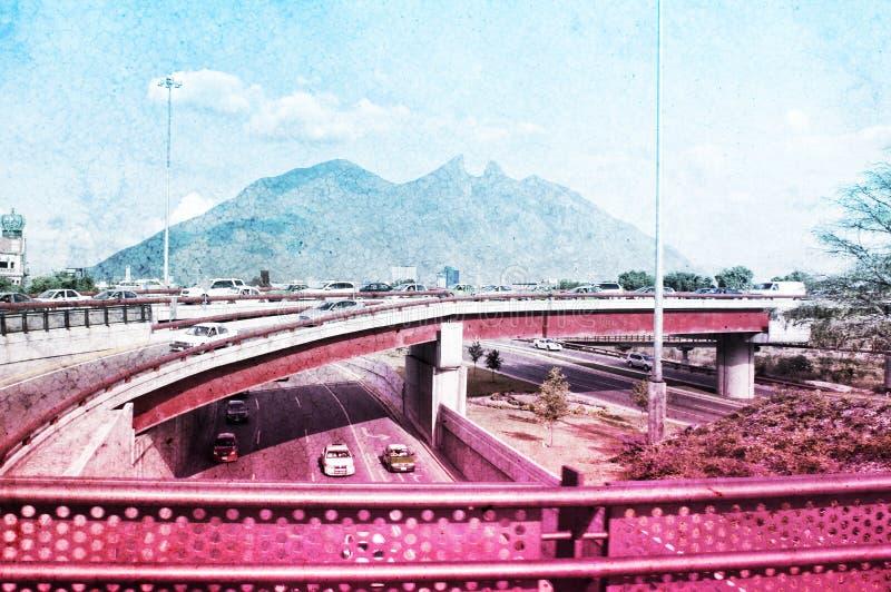 Cerro de la Silla Monterrey Mexico. Photograph of the city of Monterrey Mexico and its characteristic `Cerro de la Silla` mountain with color gradient royalty free stock photography