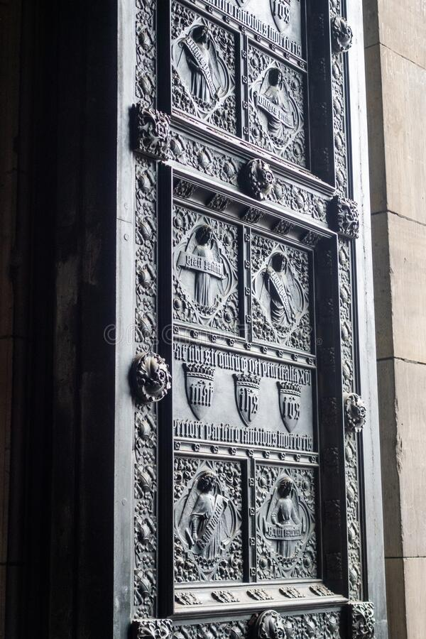 Cologne Cathedral door wing with rich relief decoration stock photography