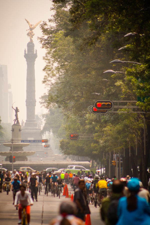 Photograph of cyclists at Mexico City. Angel Independencia behind stock photo