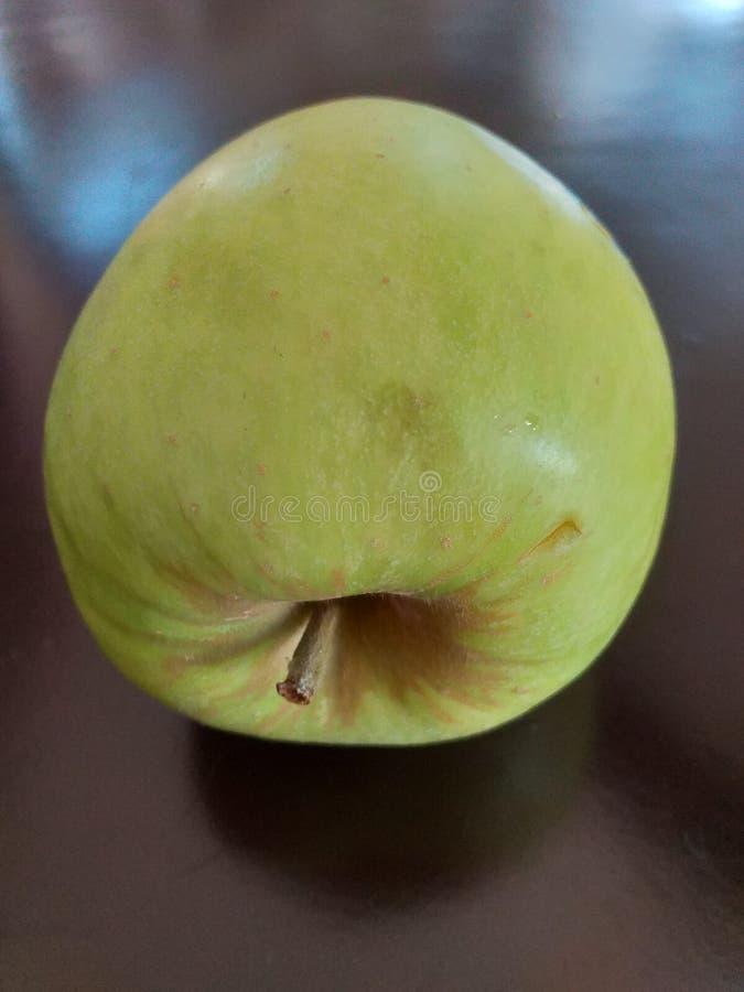 Photograph depicting an apple. Photograph depicting apple fruit green stock photos
