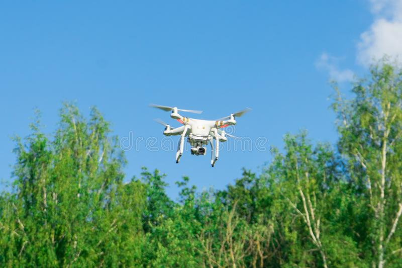 Photograph of a flying drone. Modern entertainment. stock images