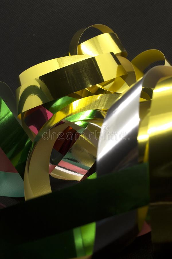 Metallic Ribbons. This is a photograph of Gold,Silver,Green and Red Metallic Ribbons placed infront of a Black background royalty free stock photos