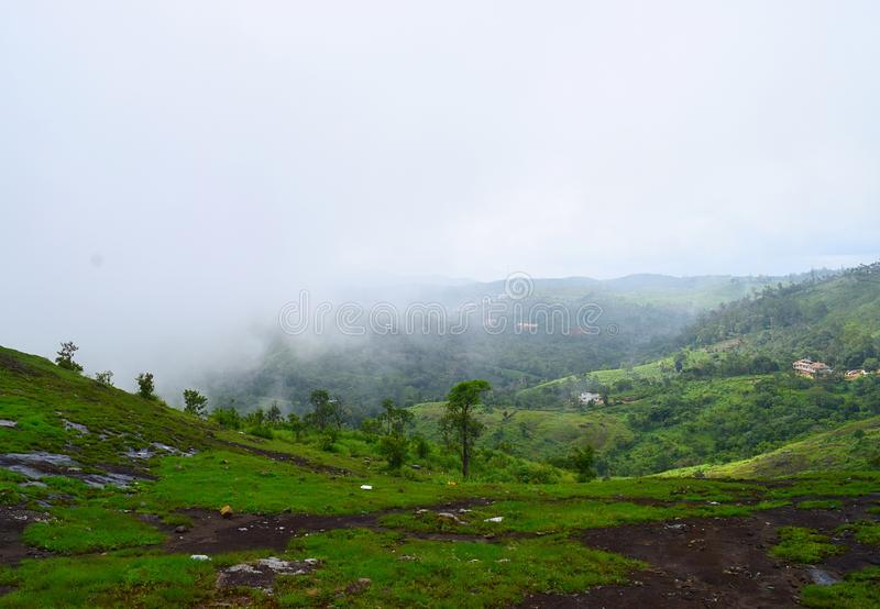 Misty Green Hills in Western Ghats - Peerumedu, Idukki District, Kerala, India - Natural Background. This is a photograph of misty green hills in Peerumedu in stock image