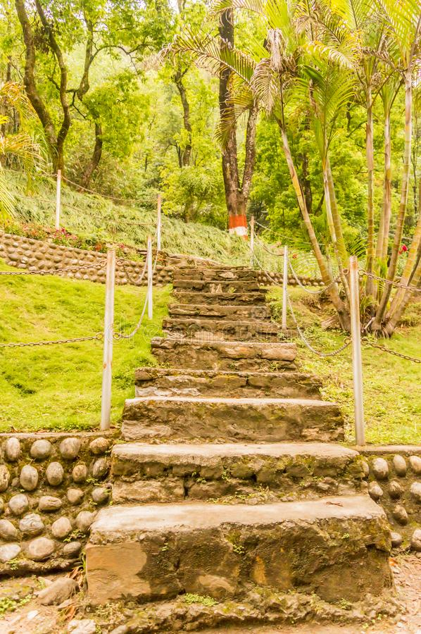 Natural stone landscaping in home garden with stairs royalty free stock photography