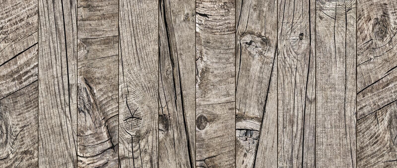 Photograph of old weathered cracked knotted Pine wood floorboards grunge texture detail royalty free stock images