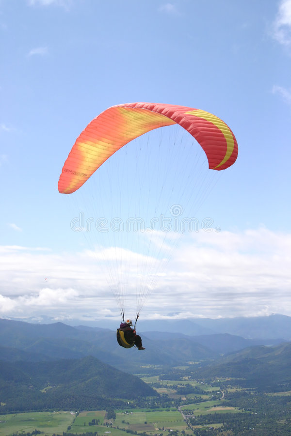 Photograph of a Paraglider Pilot Soaring stock images