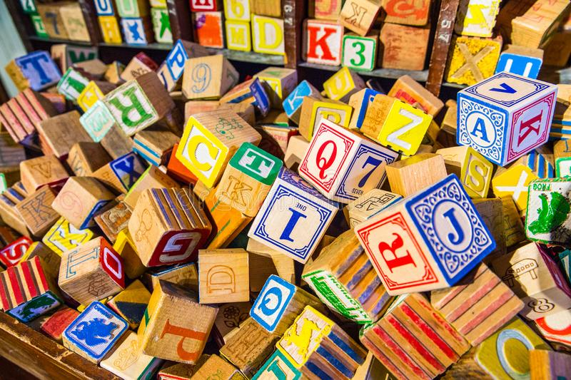 Pile of colorful children's vintage alphabet wooden block toys royalty free stock photo