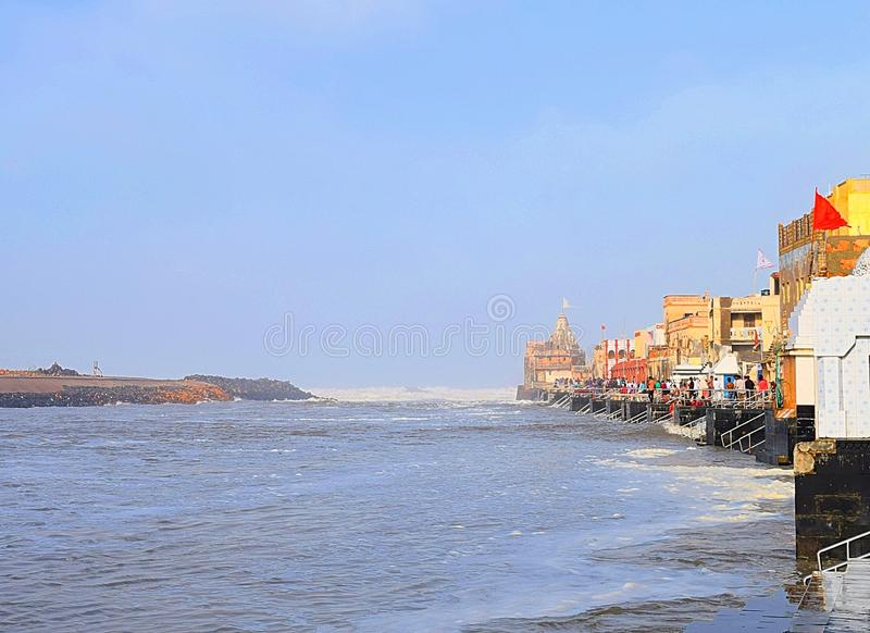 Sacred Gomti River meeting the Ocean, Indian Traditional Ghats and Hindu Temple at Distance - Devbhoomi Dwarka, Gujarat, India. This is a photograph of sacred royalty free stock photos