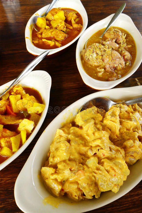 Asian curry dishes buffet. A photograph showing a few assorted stewed curries dishes made with different ingredients. Exotic asian cuisines, include banana curry royalty free stock image