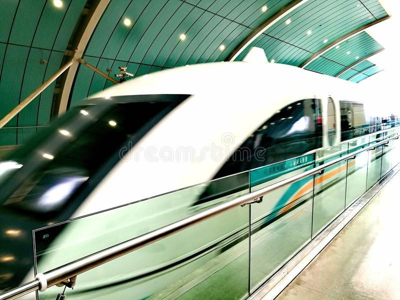 Shanghai MagLev train approaching station. A photograph showing the high speed ultra modern magnetic levitation train at the Shanghai Pudong station, approaching stock photos