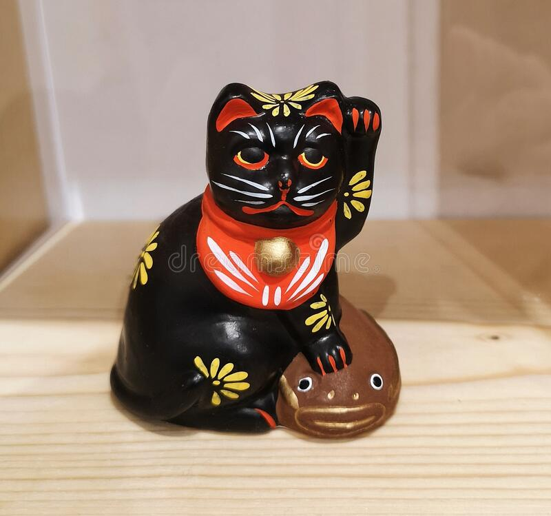 Antique Japanese wooden toy cat royalty free stock images