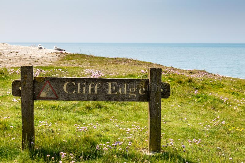 Cliff Edge Sign. A photograph of a sign warning of the cliff edge in Seaford, Sussex stock photos