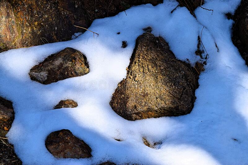 Abstract Natural Background and Texture - Pattern with Snow Crystals and Stones in Light and Shade stock photo