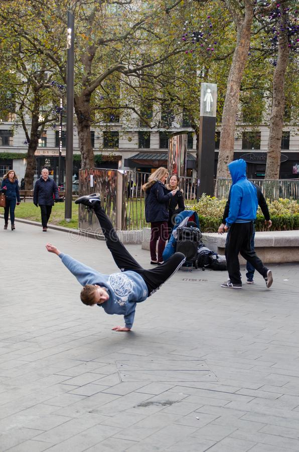 Photograph of some guys doing break dance in the streets of London, United Kingdom. stock image
