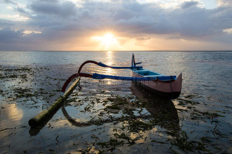 Fishing boat is parked on the shore in Bali, Indonesia. royalty free stock photography