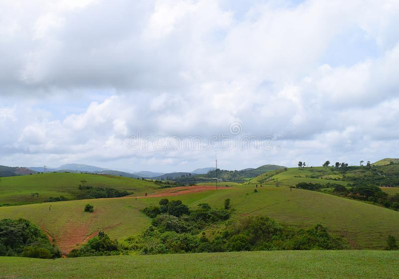 Vagamon Hills and Meadows - Green Fields and Open Sky, Idukki, Kerala, India. This is a photograph of Vagamon hills and meadows, with open sky and green fields stock image
