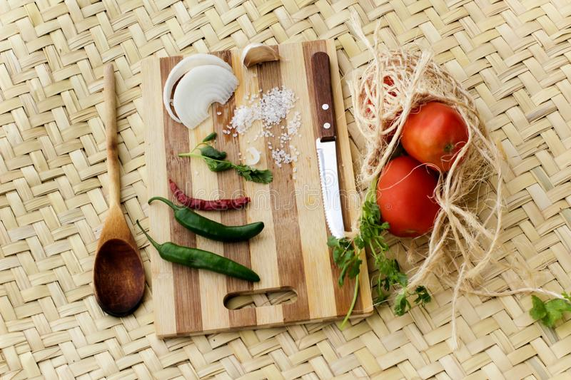 Cutting board with vegetables stock image