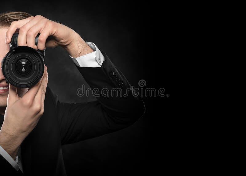 Photographe avec l'appareil-photo photographie stock libre de droits