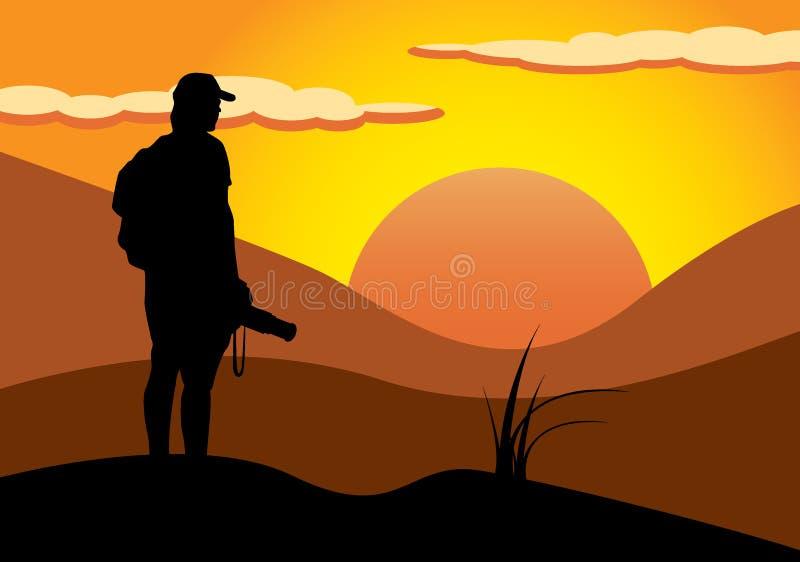 Photographe dans le coucher du soleil photos stock