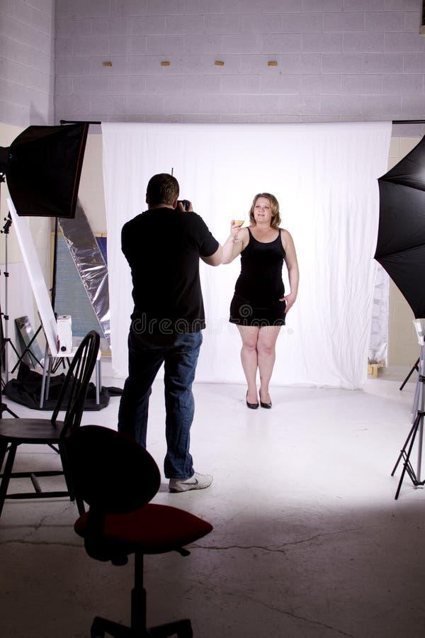 Photographe dans le studio images libres de droits