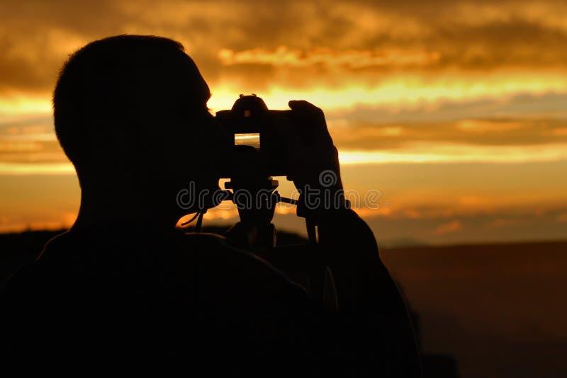 Photographe de coucher du soleil images stock