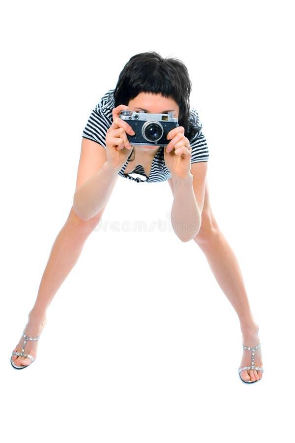 Photographe de fille de beauté dans le gilet du marin avec l'appareil-photo de photo photos stock