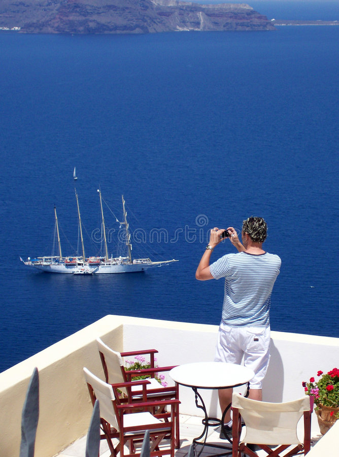Photographe de touriste de Santorini photographie stock libre de droits