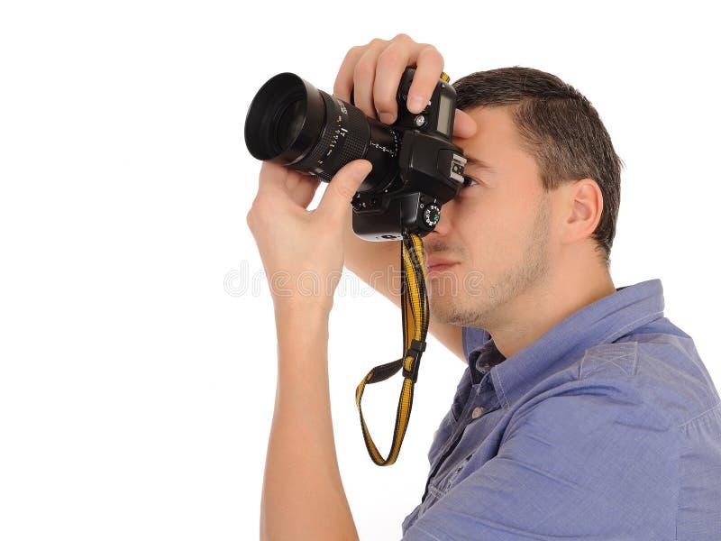 Photographe mâle professionnel prenant la photo images libres de droits