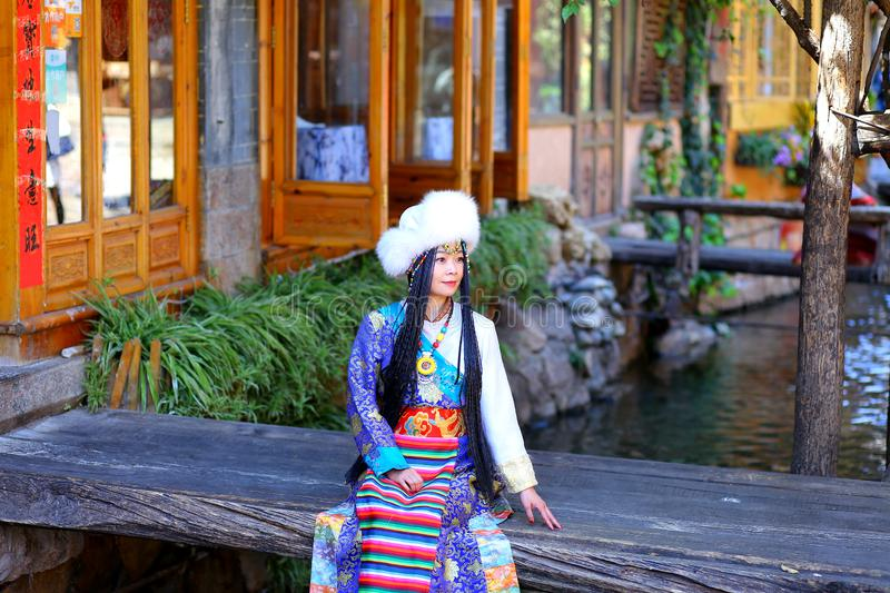 Beautiful girl dressed in ethnic costumes in Lijiang, Yunnan, China royalty free stock image
