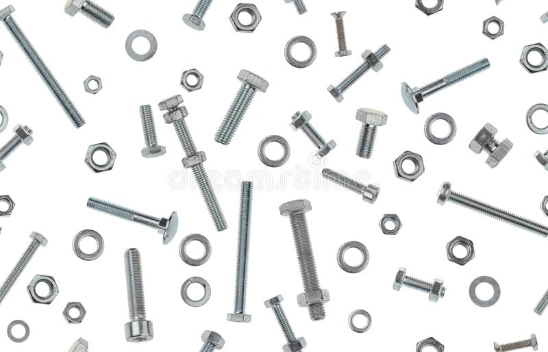 Photographed variety of metal bolts, nuts and rings on white backlit background. Seamless image to be repeated endlessly. stock images
