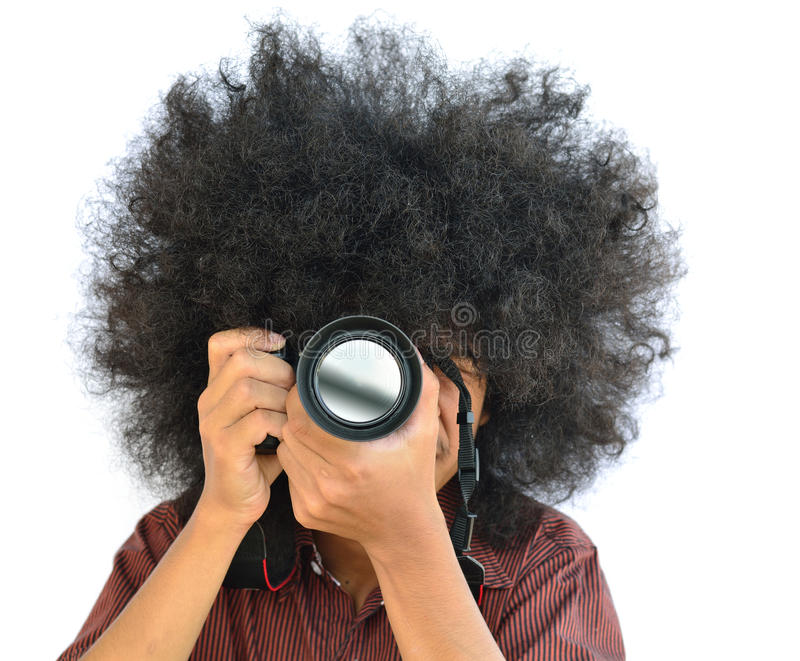 Photographer. Man with long hair and holding digital camera stock photo