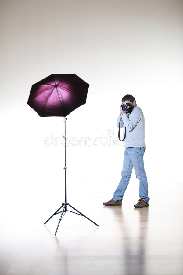Photographer. Shooting in white studio royalty free stock images
