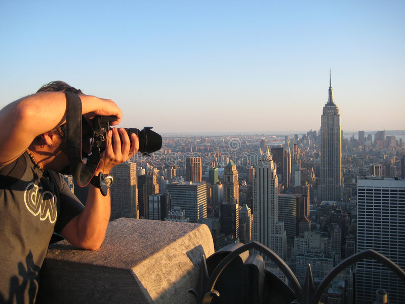 Photographer. Taking pictures to te Empire State Building at New York City royalty free stock images