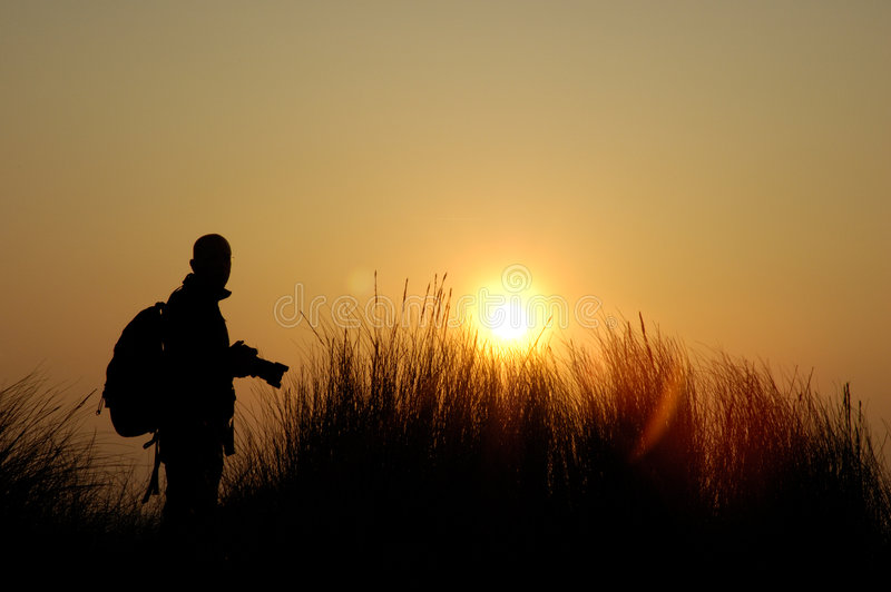 The photographer. Man is taking a picture from the sunset on the island sylt, germany stock photo