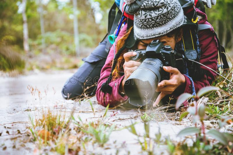 Photographer asian woman Traveling photograph Nature. travel relax in the holiday walk in the forest. travel relax in the holiday. Thailand stock photo