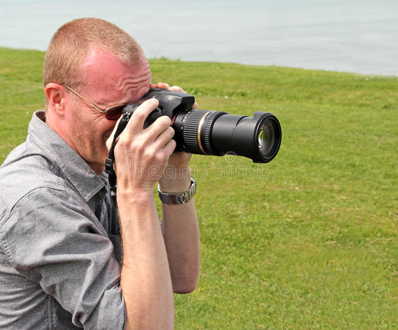 Photographer cameraman by sea royalty free stock image