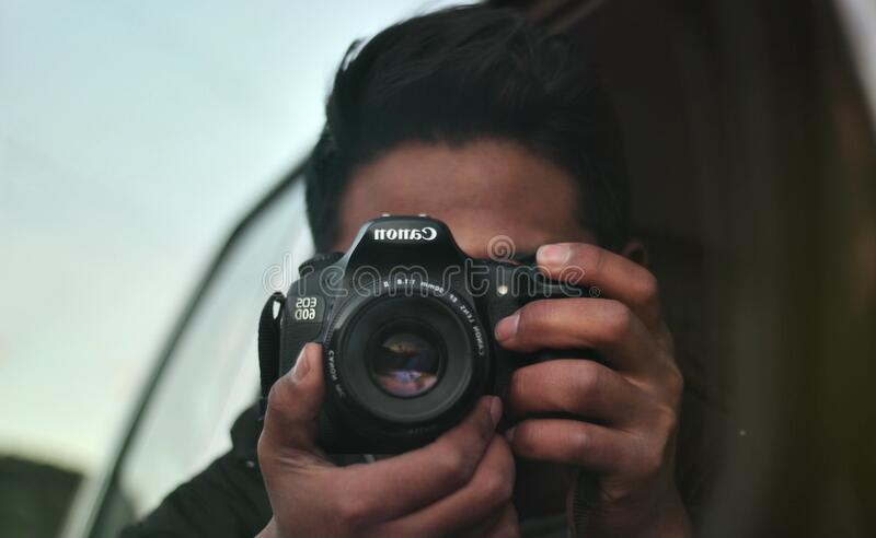 Photographer with Canon camera stock images