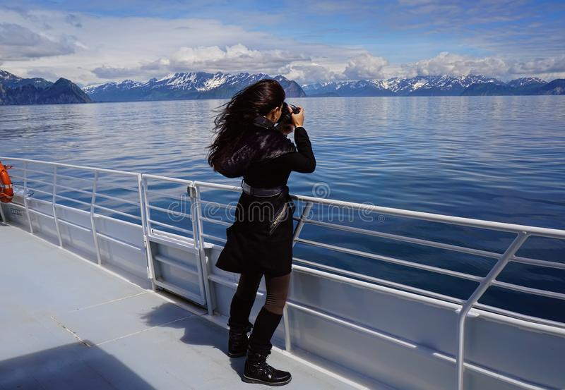 Photographer capturing exit glaciers royalty free stock photography