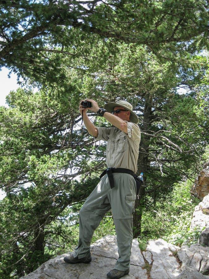 Photographer at work on high Sandia Mountains overlook stock photo