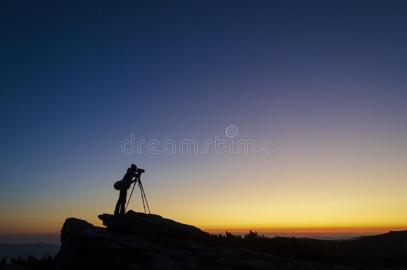 Photographer capturing sunset landscape royalty free stock photos