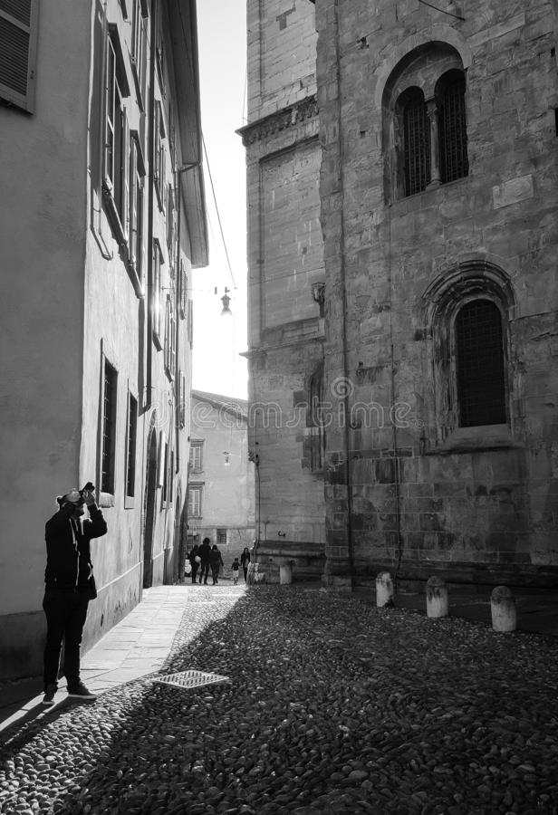 Photographer in the center of the old town of Bergamo,Italy. royalty free stock image