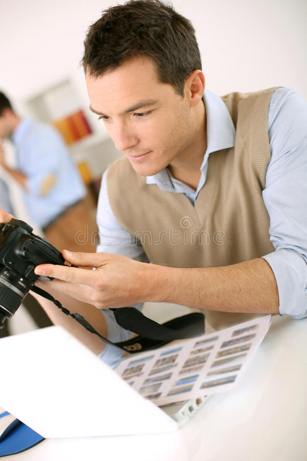 Photographer checking pictures on camera royalty free stock photos