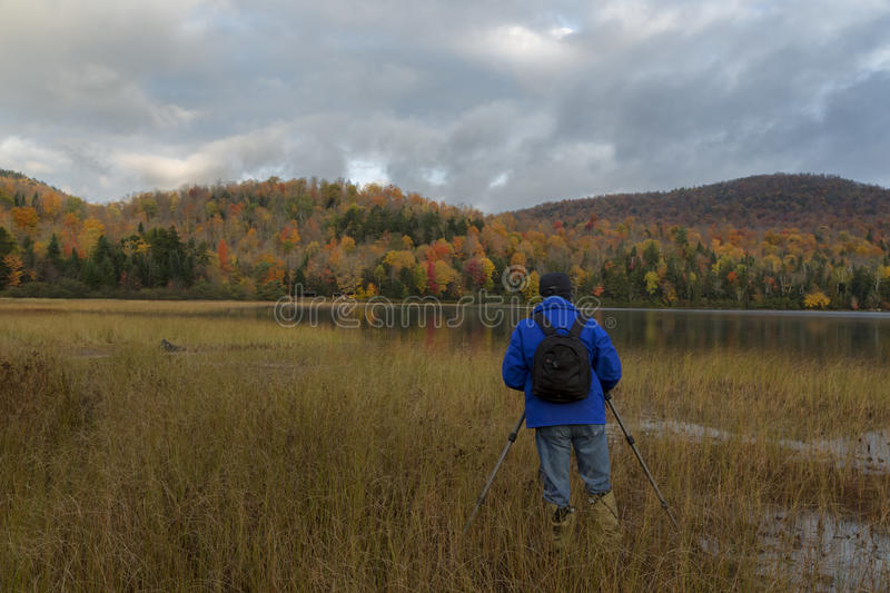 Photographer at Connery Pond. Adirondack Park, New York royalty free stock image