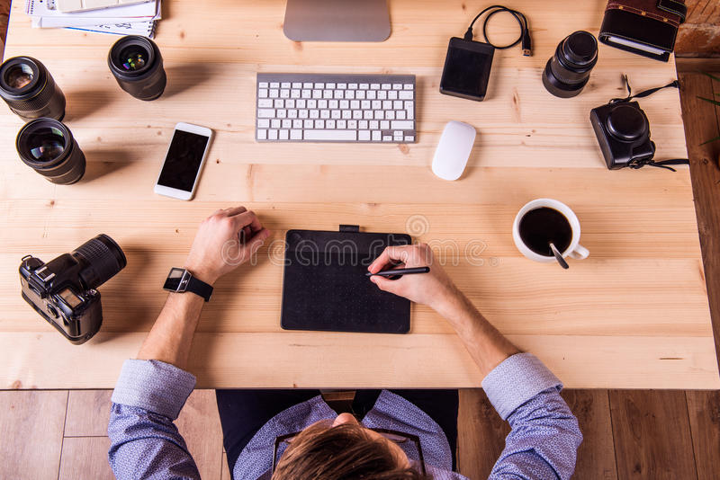 Photographer at the desk, office gadgets and object lens stock photography