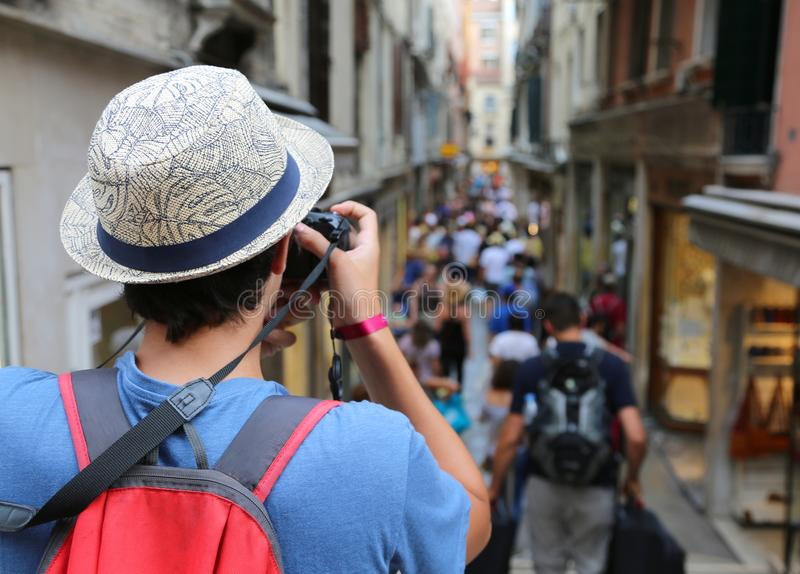 Photographer with digital camera takes many photos in Venice in royalty free stock images
